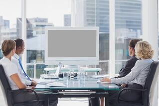 Group of business people looking at a screen during a video conference.jpeg