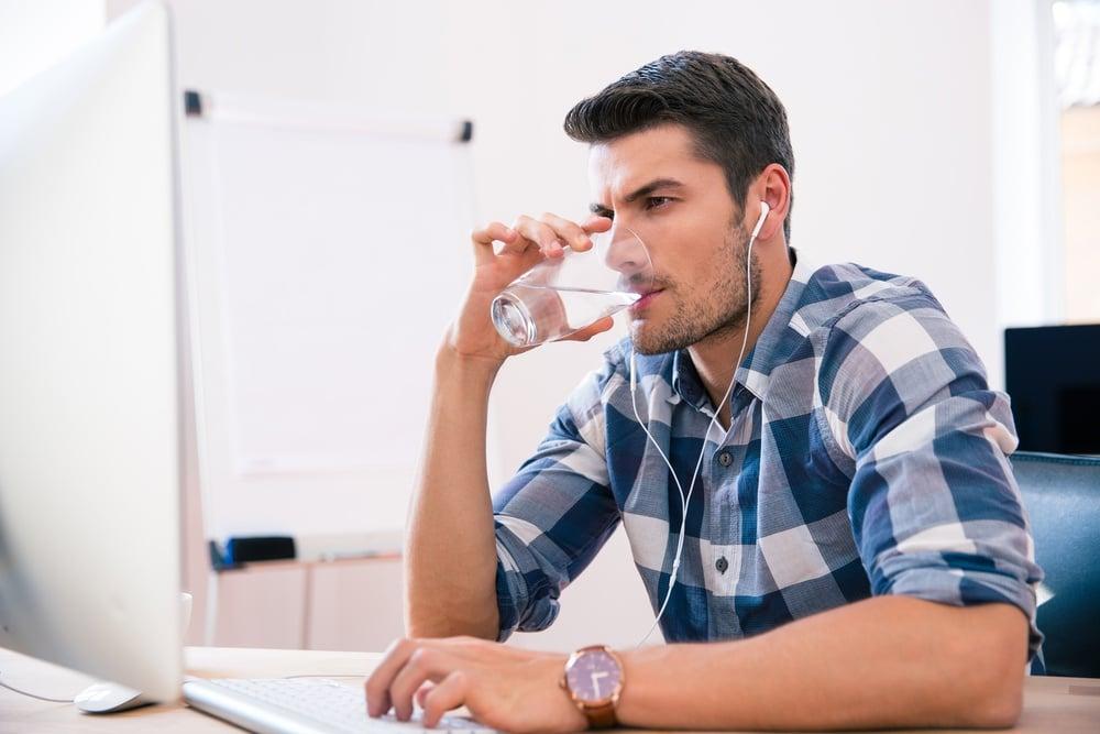 Man wearing headphones in office privacy